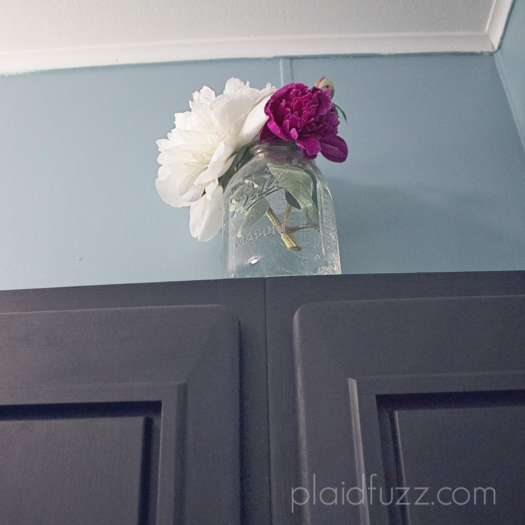 Peonies in mason jar in bathroom